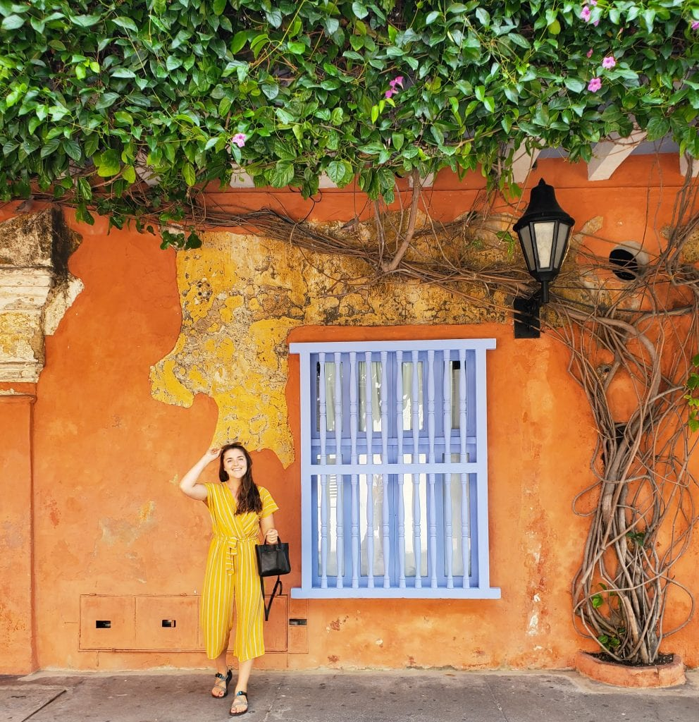 Female Traveler in front of Colorful Cartagena Wall