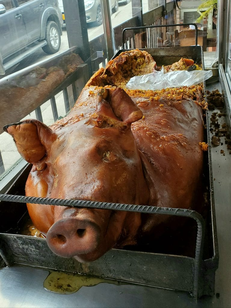 lechon pig lunch in manizales colombia